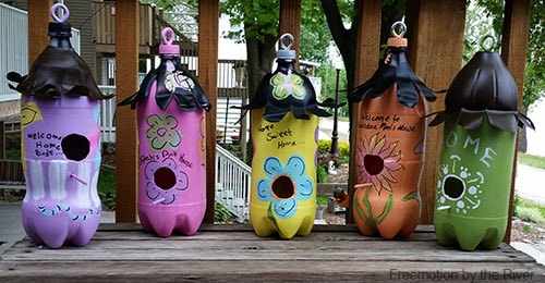 5 DIY soda bottle birdhouses tutorial on a bench