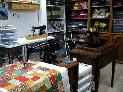 Quilt studio getting cleaned and vintage sewing machines