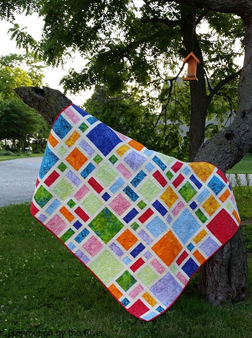 Scattered quilt pattern in brights and batiks