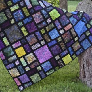 Scattered quilt pattern in black and batiks