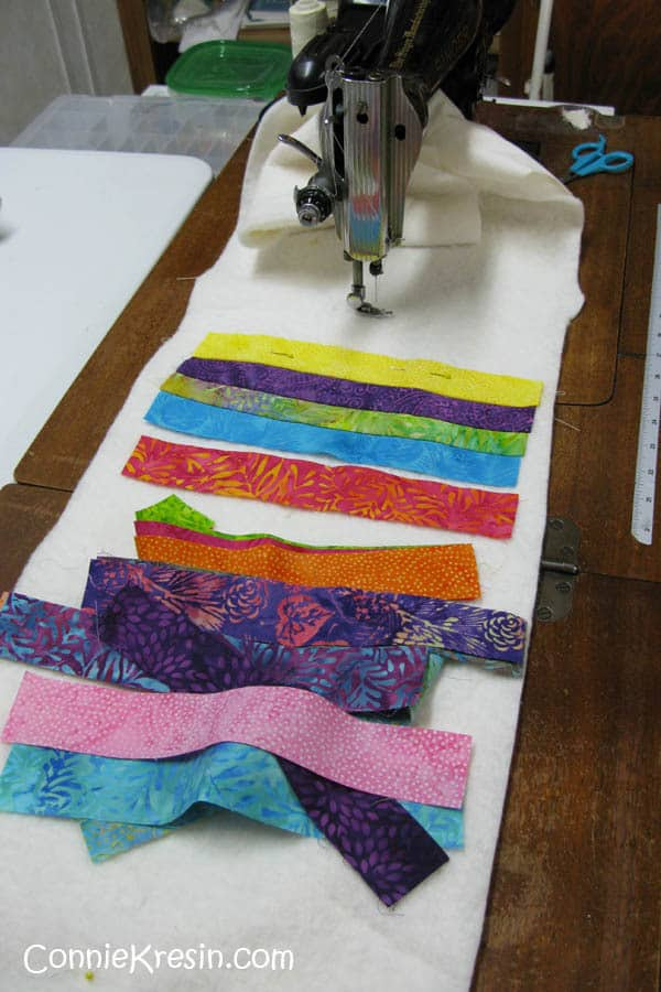 Sewing together the batik strips for the string tablerunner