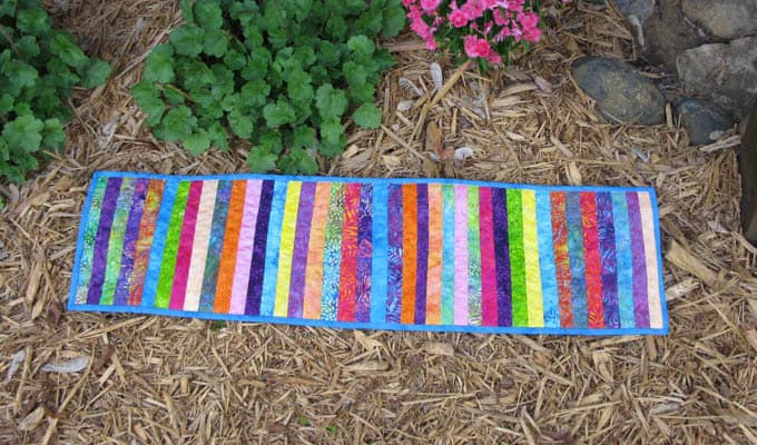 String Batik Tablerunner outside in garden