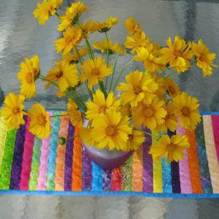 String Batik Tablerunner outside with flowers