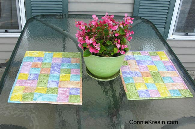 Happy place mats with flowers on glass table on deck