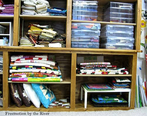 Quilt Studio shelves with lots of fabric stash