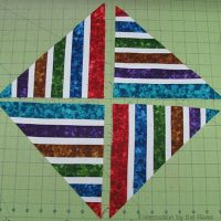 Bright Jewel Strip Pieced Table Runner Tutorial