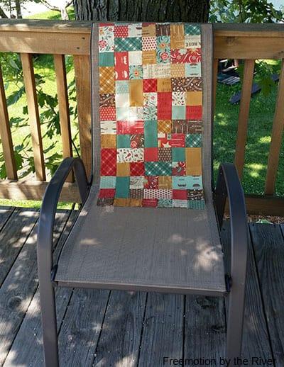 pieced runner on a deck chair