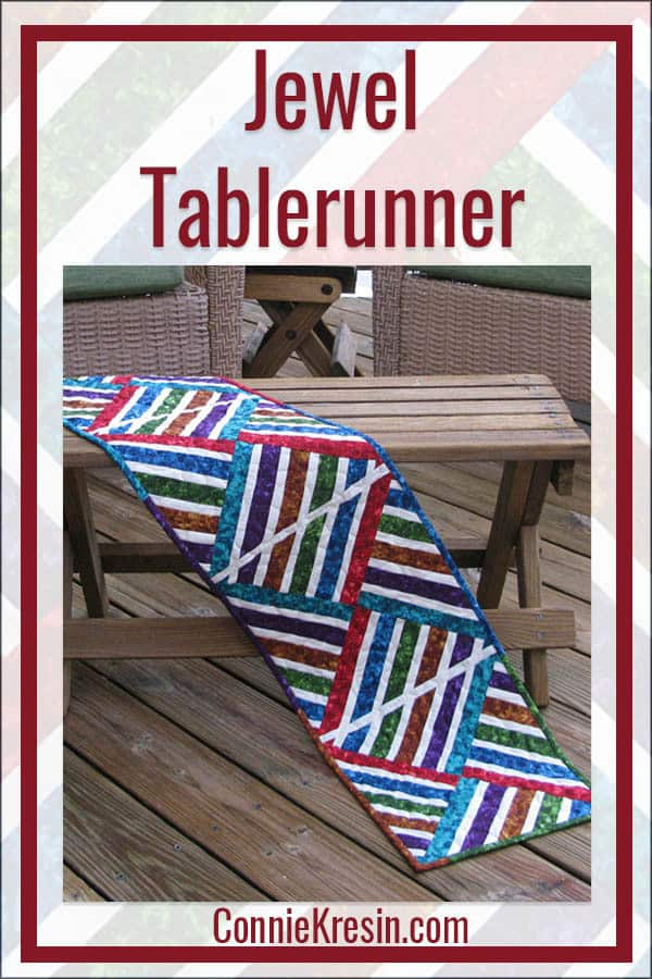 Red Jewel Tablerunner that is fast and easy to make using the strip piecing quilt method