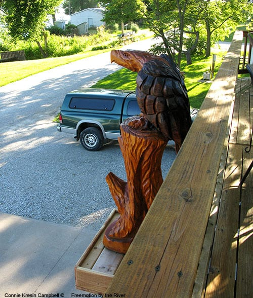 Wood carved eagle on our deck