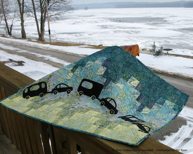 Iggy with his Caravan quilt made with Crystal Cove collection from Island Batik