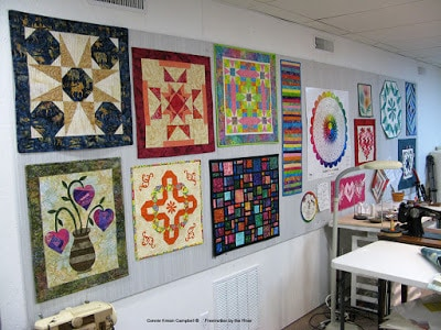 Quilts hanging on my design wall in my new studio