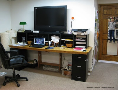 8 foot desk in my quilt studio for Wii, exercise, movies and screen for my laptop