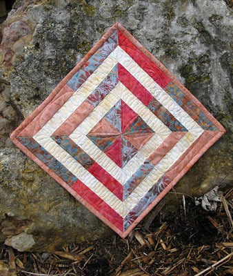Crystal Cove Swirl mini quilt made with batiks