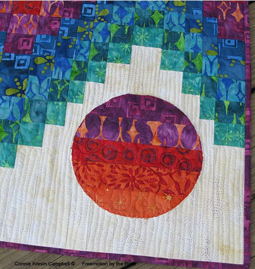 Closeup of quilting on the batik quilt