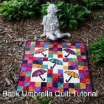 Batik Umbrella Quilt with a angel watching over it