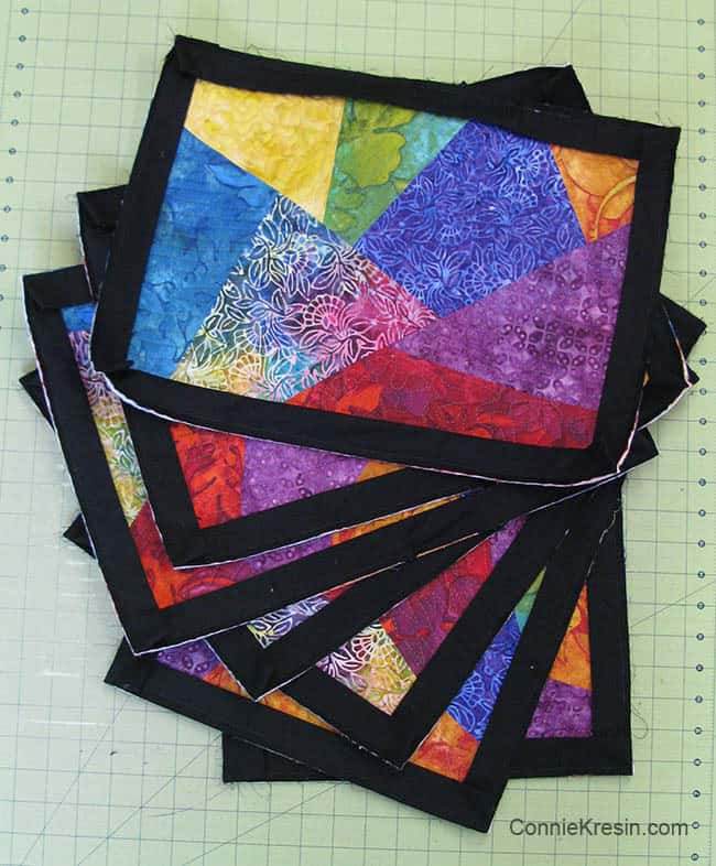 Colorful psychedelic placemats are fun to make adding the binding