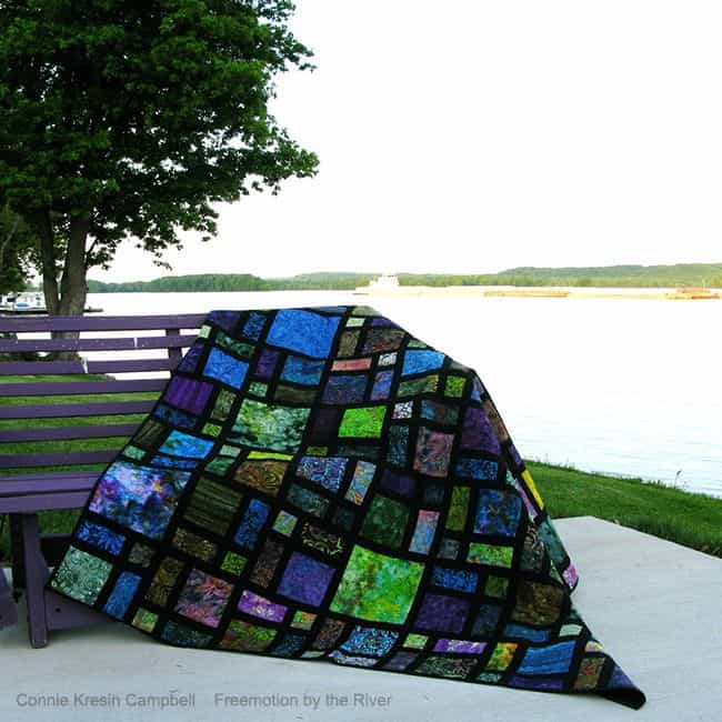 Scattered quilt down by the river