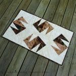 modern Batik quilt on deck
