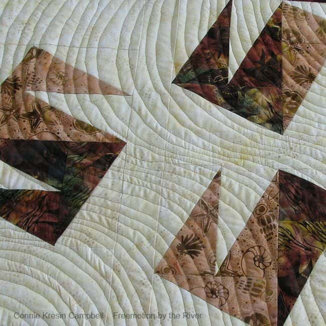 Modern Wind quilt in batik closeup
