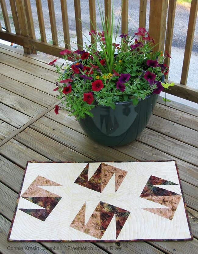 Modern Wind table topper made with batiks