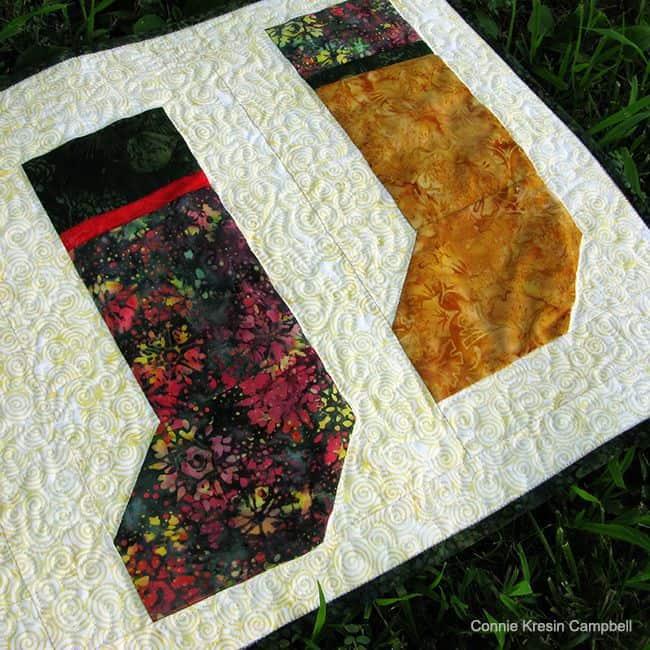 Christmas Stockings table runner in batik closeup