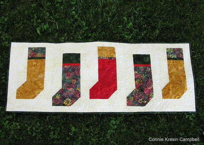 Christmas Stockings table runner made with batiks