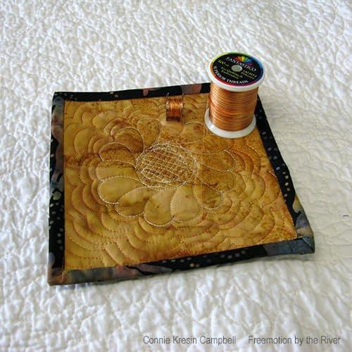 Gold Mug Rug stitched with Superior Fantastico thread