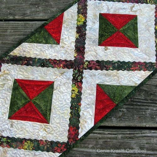 Happenings quilted table Runner closeup