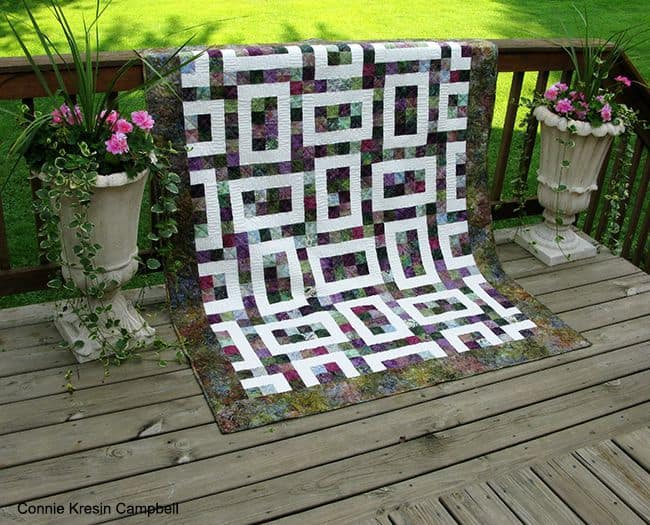 Hopscotch Batik Quilt #2 on deck rail