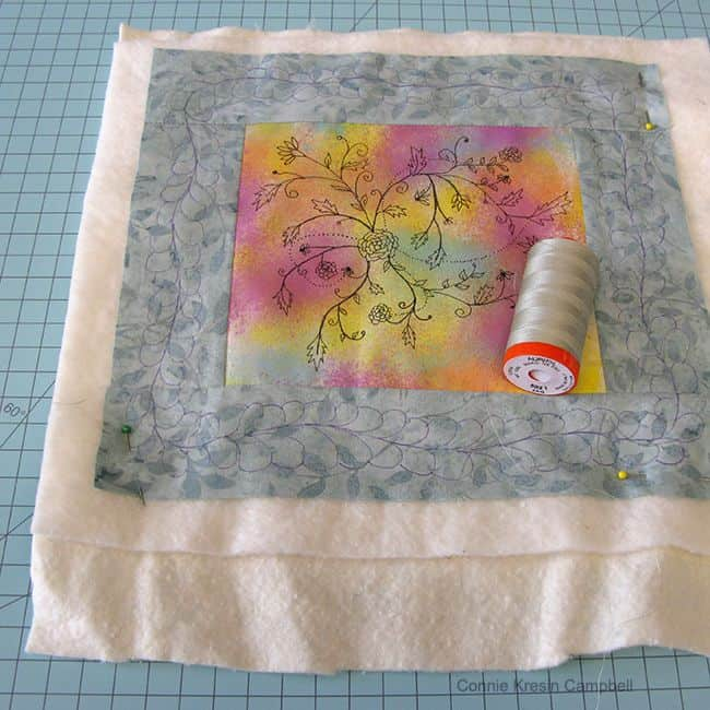 Ink Flowers with two layers of batting and Aurifil thread