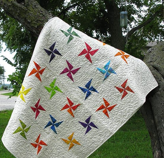 Baby batik quilt in a tree