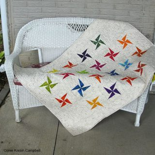 Baby quilt on a bench