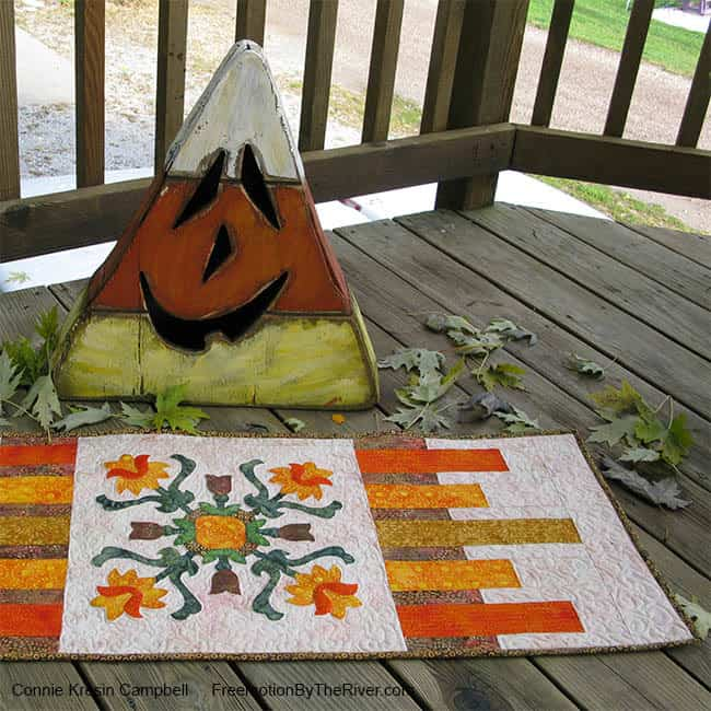 Applique table runner with Halloween Candy Corn