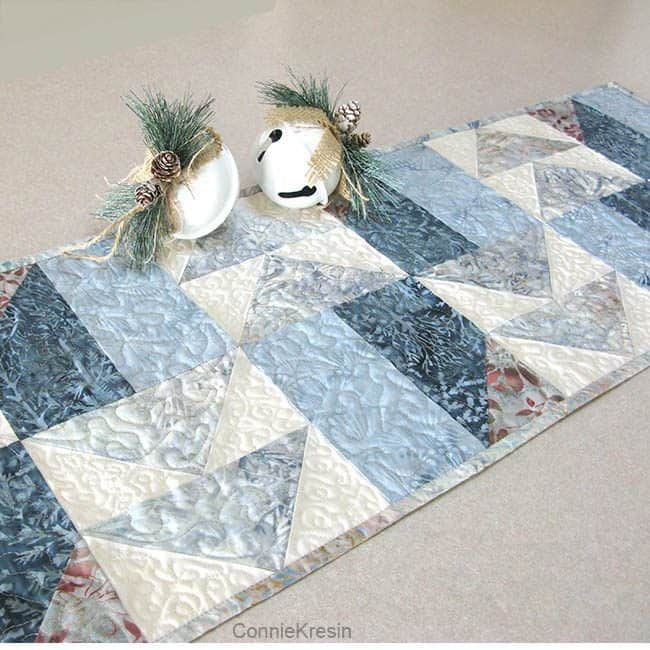 AccuQuilt Winter Blues table runner with Christmas bells