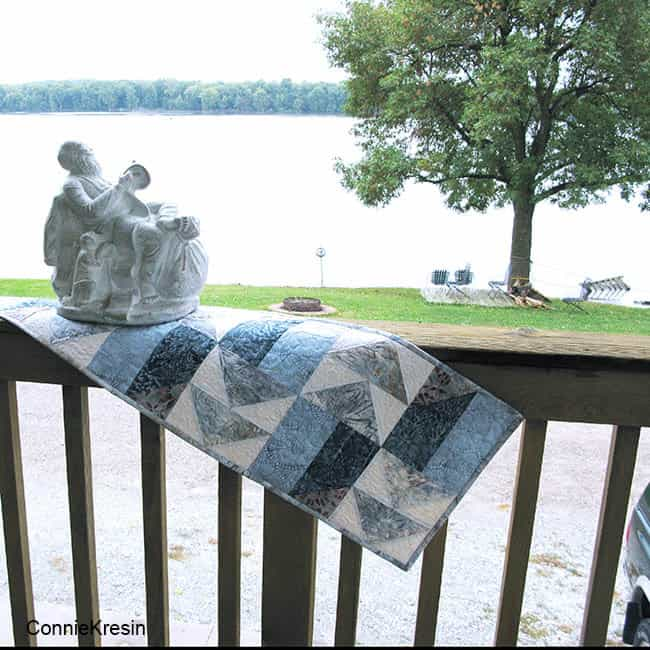 AccuQuilt Winter Blues table runner on deck rail