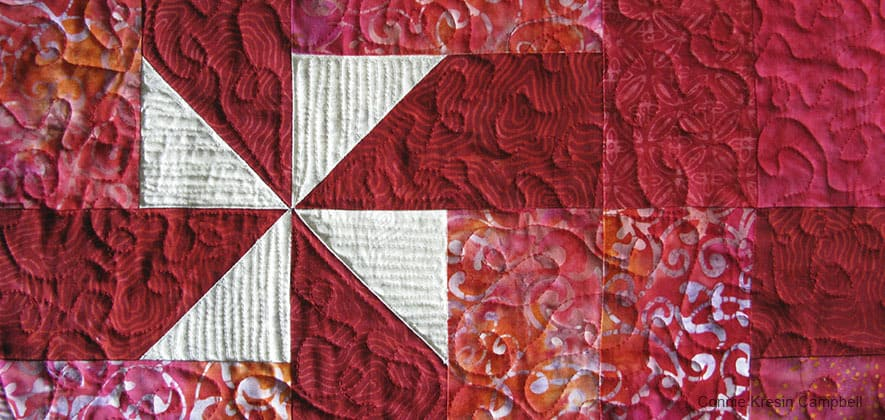 Free motion quilting on the Christmas Pinwheels table runner