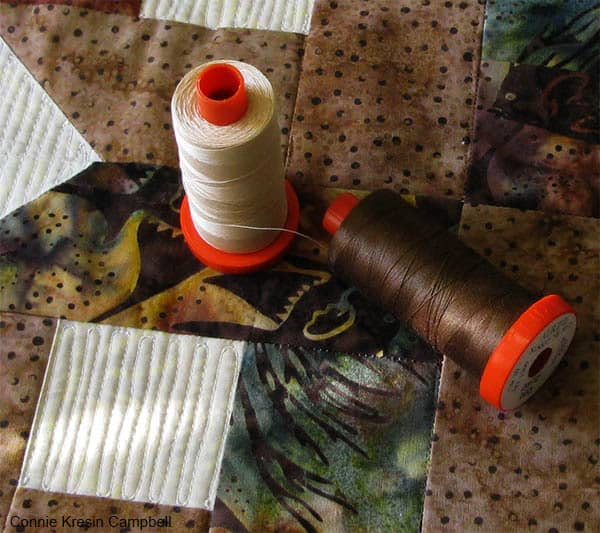 Batik Box Quilt Block pillow with Aurifil thread