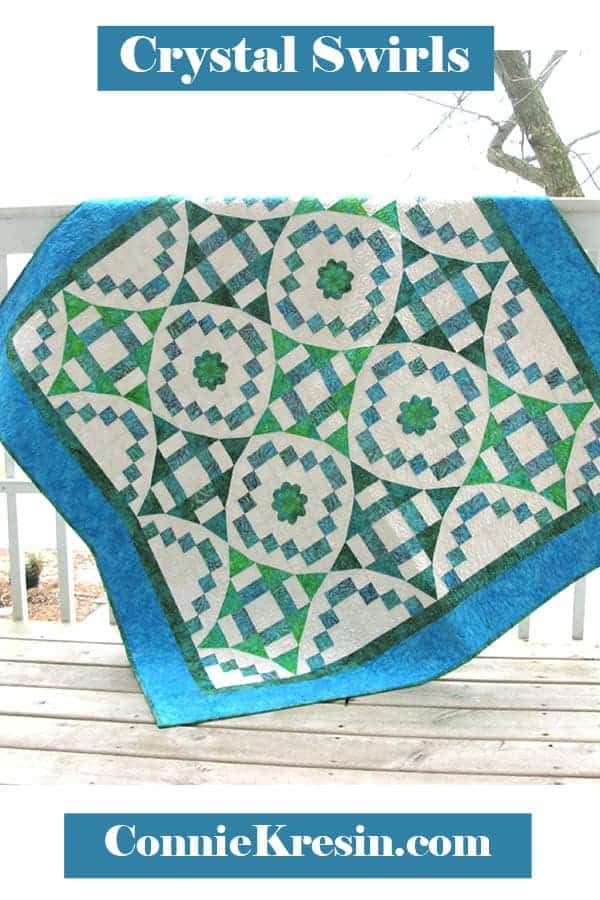River Swirls quilt pattern with applique flowers