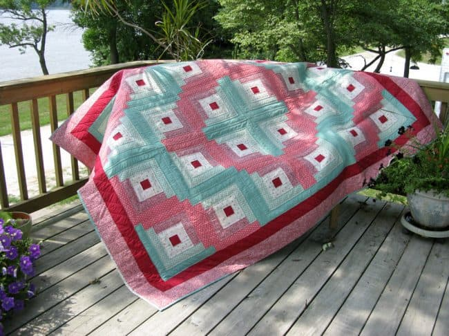 Hand quilted Log cabin quilt in a day