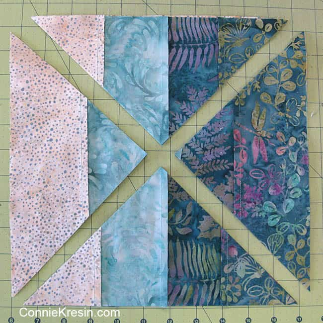 Teal table topper sewing blocks together and cutting diagonally