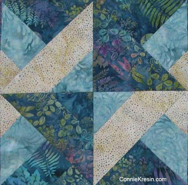Closeup of the teal quilt block with strips