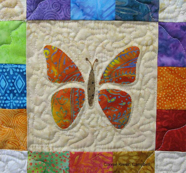 Closeup of appliqued butterfly baby quilt