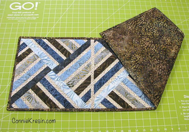Jewel table runner with minimal quilting on it back of quilt