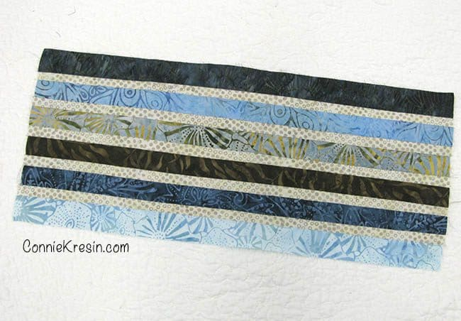 Strip pieced Jewel table runner sew fabric strips together to create fabric