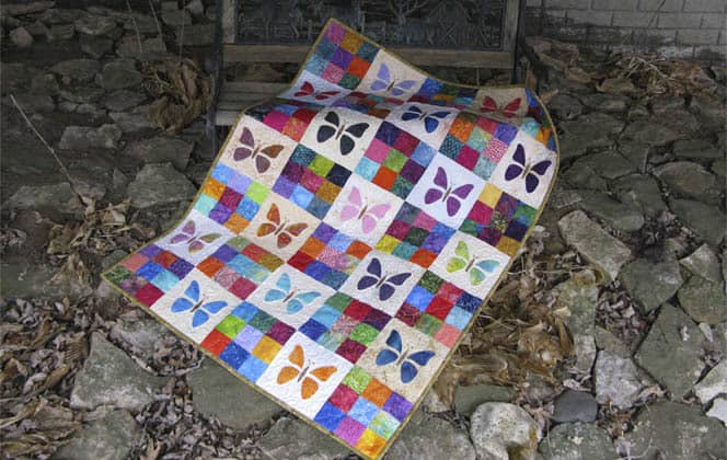 Scrappy butterfly Baby Quilt Tutorial in leaves