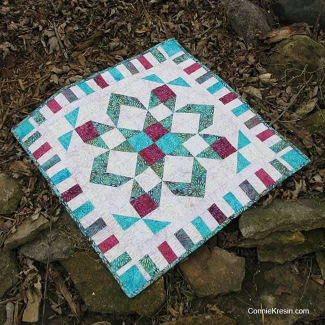 Star flower batik quilt made with Coastal Mist from Island Batik