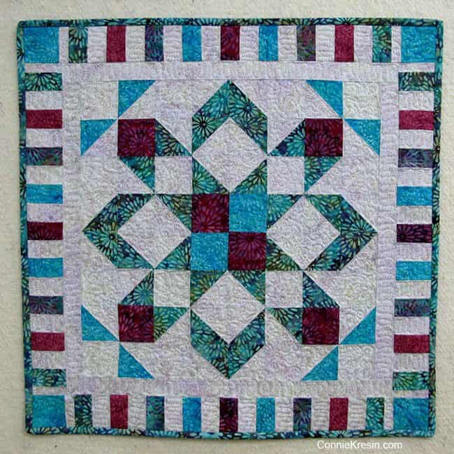 Star flower quilt on design wall