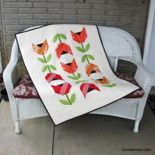 Dutch Tulips baby quilt on bench