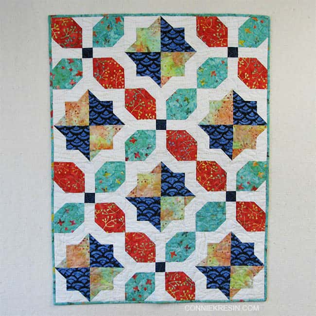 Morning Glory baby Quilt on design wall