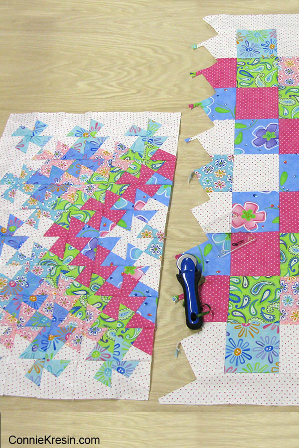 Lil' Twister baby quilt comparing size of quilt before cutting blocks